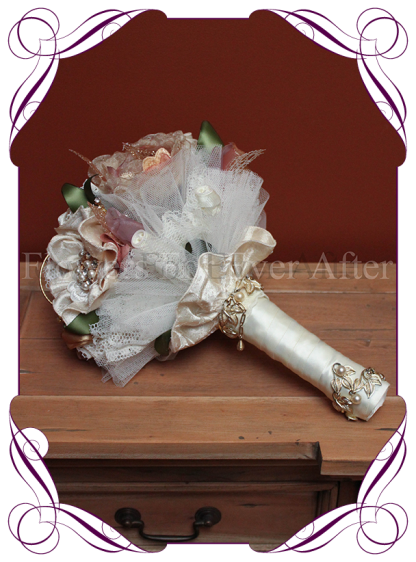 Vintage glamour elegant bridal bouquet design. Features all hand made fabric flowers, each set with brooches. Fabrics used are in ivories, creams, champagnes, dusty pinks, apricots and golds, with scattered gold wired diamante crystals, gold metal loops and laces. brooch bouquet, bling bouquet