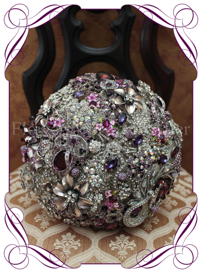 A unique and glamorous Gatsby style vintage bouquet. A large 9 inch brooch bouquet in silvers, crystals and purples.
