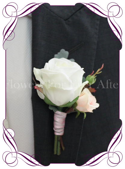 Silk grooms, groomsmans flower. White and pink artificial rose on fake foliage. Elegant gents button boutonniere