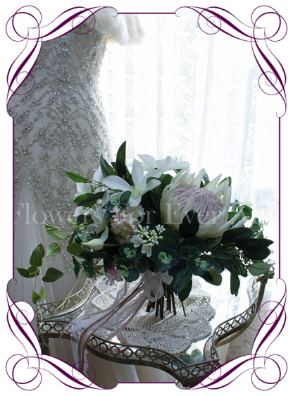 Silk artificial bridal bouquet with white clematis, blush pink lilacs, king protea and Australian native gum and eucalypt foliages. Made in Melbourne, and shipped internationally. Custom Orders Welcome!