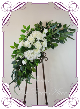 Silk artificial native eucalypt gum leaves, white hydrangea and rose wedding arbor arch table decoration. Can be a package with matching tieback flowers. Made in Australia. Buy online.