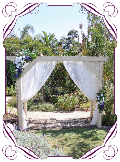 Silk artificial corner style blue galaxy orchids, white hydrangea and rose wedding arbor arch table decoration. Can be a package with matching tieback flowers. Made in Australia. Buy online.
