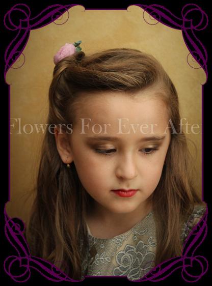 Silk artificial boho rustic wedding hair floral pin with a deep purple ranunculi, and a fine foliage spray.
