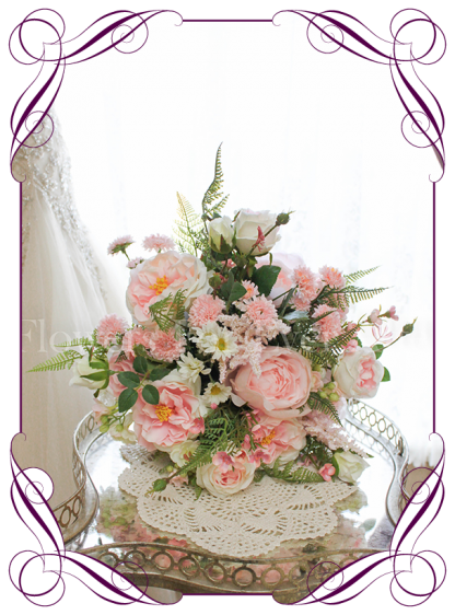 Pink silk artificial wedding bridal posy bouquet. Realistic design in high quality roses, peonies and fine flowers. Buy online, shipping worldwide immediately.