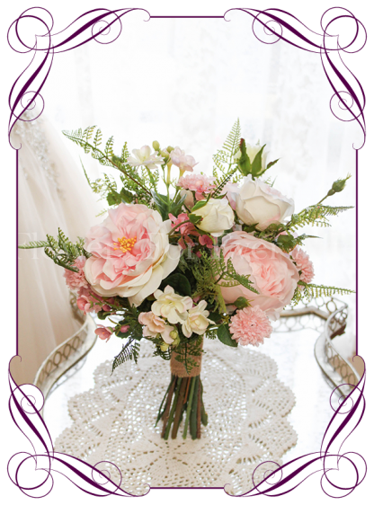 Pink silk artificial wedding bridesmaid posy bouquet. Realistic design in high quality roses, peonies and fine flowers. Buy online, shipping worldwide immediately.