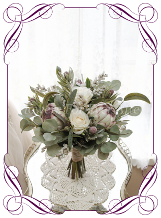 A Gorgeous Silk Artificial Bridal Bouquet package set, featuring faux flower roses, ivory protea, australian natives, and textures, gum leaves eucalypt, in a romantic elegant and unusual bridal style,traditional wedding bouquets. Made in Melbourne by Australia's Best Artificial Bridal Florist. Worldwide Shipping available