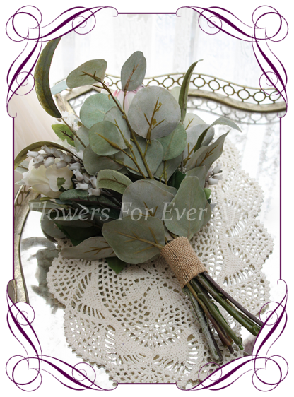 A Gorgeous Silk Artificial Bridesmaids Bouquet package set, featuring faux flower roses, ivory protea, australian natives, and textures, gum leaves eucalypt, in a romantic elegant and unusual bridal style,traditional wedding bouquets. Made in Melbourne by Australia's Best Artificial Bridal Florist. Worldwide Shipping available