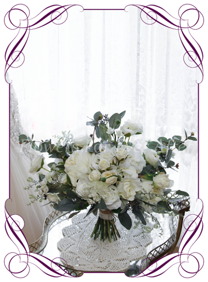 A romantic Silk Artificial Bridal Bouquet posy, featuring faux flower white ivory roses, peonies, silver blue gum and textures in a classic bridal style, pink wedding flowers, traditional wedding bouquets. Made in Melbourne by Australia's Best Artificial Bridal Florist. Worldwide Shipping available