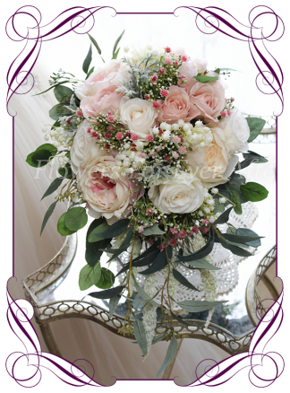 Silk faux flower cascading bridal Bouquet, brides bouquet featuring silk roses in blush, pink, ivory with baby's breath and native gum leaves foliage in a classical cascading tear style. Made in Melbourne by Australia's best silk wedding florist. World wide shipping. Buy online.
