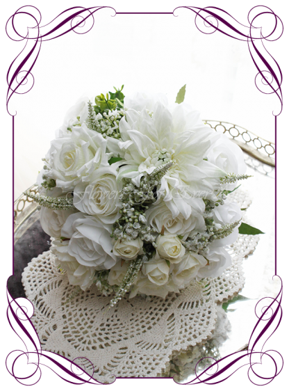 Silk artificial wedding bouquet ideas. Mixed ivory white faux silk bridal bouquet wedding flowers. Roses, peonies, baby's breath. Elegant romantic wedding posy bouquet. Made in Melbourne. Buy online. Shipping worldwide.