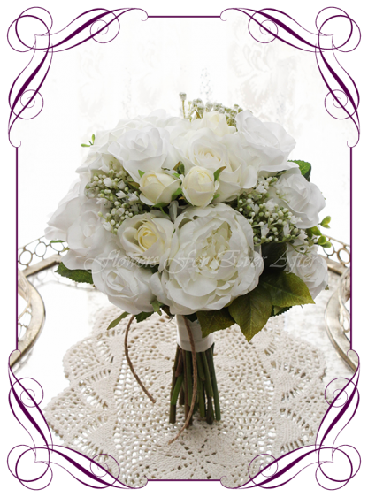 Silk artificial wedding bouquet ideas. Mixed ivory white faux silk bridesmaid bouquet wedding flowers. Roses, peonies, baby's breath. Elegant romantic wedding posy bouquet. Made in Melbourne. Buy online. Shipping worldwide.