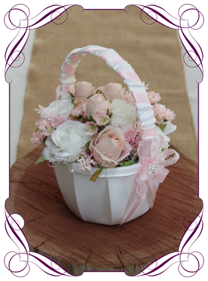 Silk artificial decorated romantic blush pink and white flower girl wedding basket. Blush roses, and white roses in a ready to go satin basket.Made in Melbourne Shipping world wide. Buy online