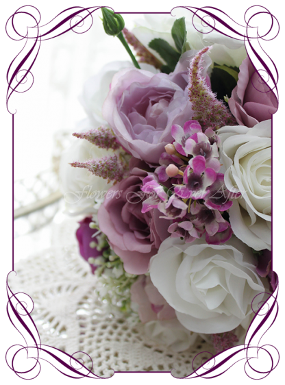 Silk artificial wedding bouquet ideas. Mixed purple lilac and white silk bridal bouquet wedding flowers. Roses, peonies, baby's breath. Cadbury purple flowers. Made in Melbourne. Buy online. Shipping worldwide.
