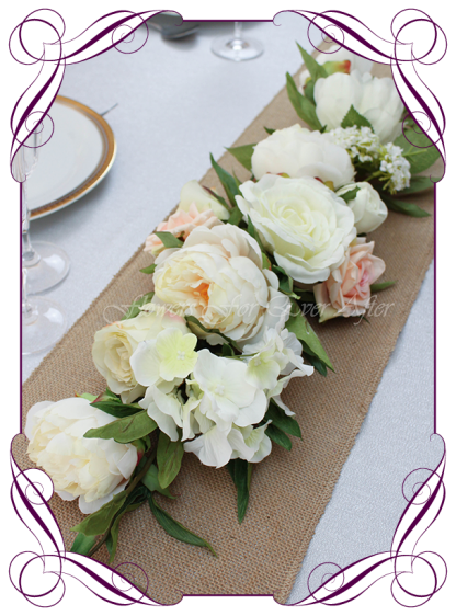 Silk faux flowers table centrepiece and sign or arbor background decorations for a wedding, engagement, birthday party, communion, confirmation, baby shower, baby shower, ideas. With white roses, peonies, champagne, ivory.. Buy online. Made in Australia. Shipping world wide.