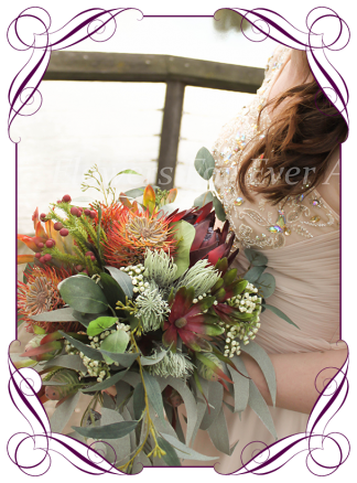 Silk artificial faux Australian native bridal bouquet, wedding flowers. Burgundy and burnt orange rust, protea banksia gum leaf foliage. Made in Melbourne by Australia's best wedding florist. Buy online.