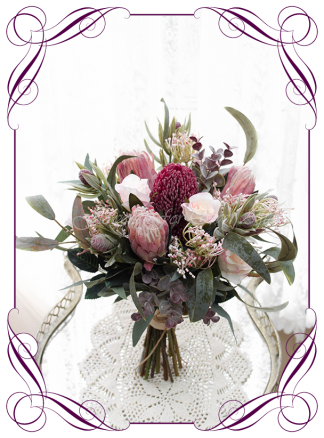 Silk artificial Native Australian burgundy and blush pink bridal wedding bouquet posy flowers. Dusty pink protea, burgundy banksia, native gum leaf foliage. Made in Melbourne. Shipping worldwide. Buy online. Package available.