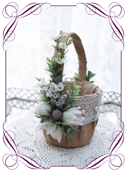 Silk artificial burlap and lace decorated rustic and Australian native flower girl wedding basket. Blushing bride protea ivory and blush. Made in Melbourne Shipping world wide. Buy online