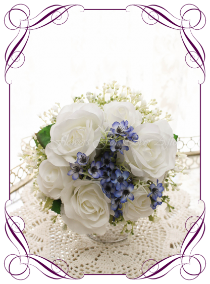 Silk artificial wedding bouquet ideas. Mixed ivory white and blue faux silk flowergirl bouquet wedding flowers. Roses, peonies, baby's breath. Elegant romantic wedding posy bouquet. Made in Melbourne. Buy online. Shipping worldwide.