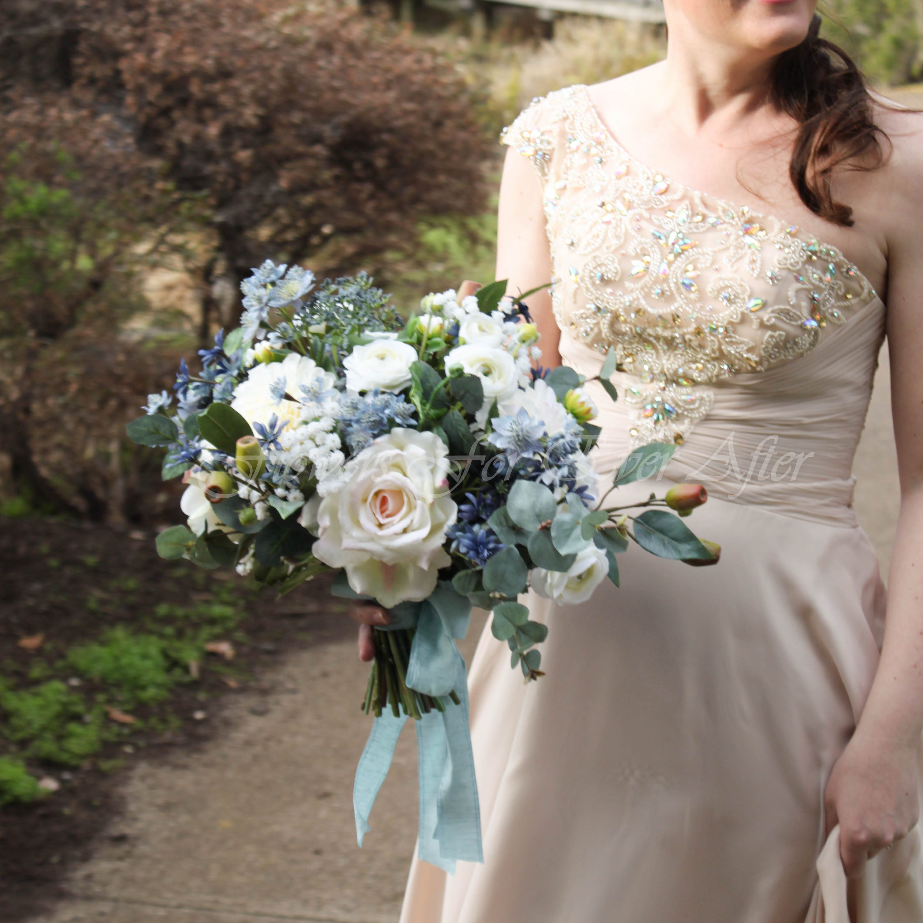 Silk Artificial Faux Fake Wedding Bouquet, filled with Artificial Roses. foliage and faux flower elements in various blue tones. Made in Melbourne by Australia's Leading Artificial wedding florist. Custom Orders Welcome & Worldwide Shipping Available.