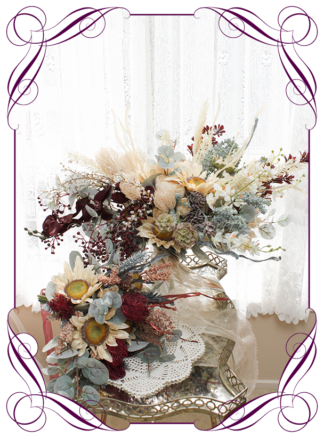 A Gorgeous Silk Artificial Boho Rustic Bridal Bouquet package set featuring faux flower roses, dark leaves, peonies, champagne flowers, meadow field flowers, sunflowers, and textures in a romantic elegant and unusual bridal style, champagne burgundy dusty blue cream wedding flowers, soft moody romantic wedding bouquets. Made in Melbourne by Australia's Best Artificial Bridal Florist. Worldwide Shipping available