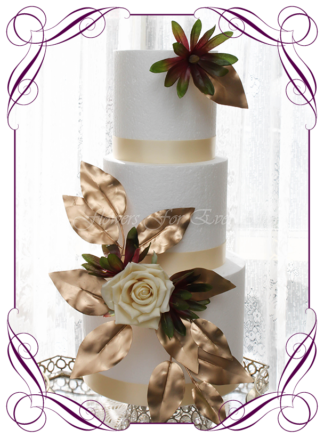 Silk Artificial burgundy and gold floral cake decoration, featuring faux flower rose, Australian natives, and gold leaves in a romantic elegant and unusual style, wedding cake, engagement cake, birthday cake. Made in Melbourne by Australia's Best Artificial Bridal Florist. Worldwide Shipping available