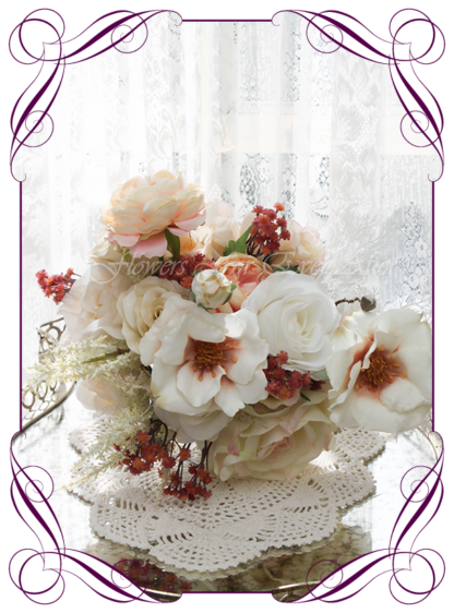 A Gorgeous Silk Artificial Bridesmaids Bouquet package set, featuring faux flower roses, dark leaves, peonies, champagne flowers, white fern, dollar, and textures in a romantic elegant and unusual bridal style, champagne pink burgundy cream wedding flowers, soft moody romantic wedding bouquets. Made in Melbourne by Australia's Best Artificial Bridal Florist. Worldwide Shipping available