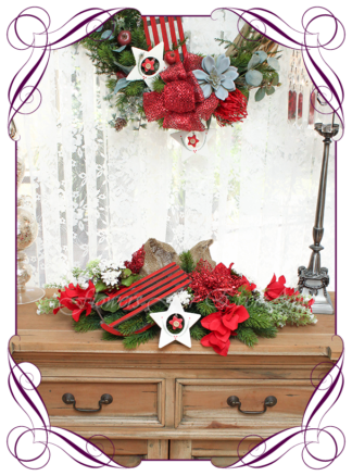 Unusual, unique Christmas table and door seasonal holiday decorations. Red and gold with Australian native Christmas. Made in Australia. Shipping world wide. Buy online, ready for Christmas. Xmas table door decorations. Table Christmas centerpiece, candelabra, door wreath hanger. Christmas stars