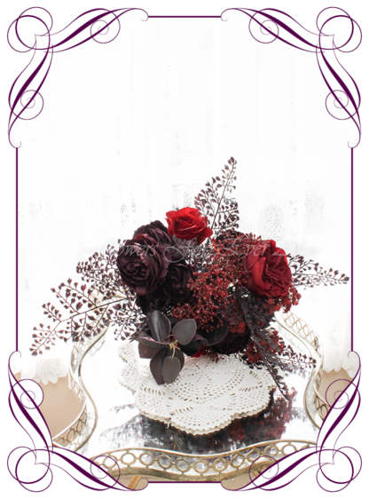 Silk artificial dark moody red, dark plum, and black wedding bridesmaids bouquet posy. Roses, peonies, unusual wedding flowers, unusual bouquet. Gothic wedding, gothic bridal flowers. Made in Melbourne by Australia's best silk florist. Buy online. Shipping worldwide