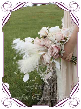 A Gorgeous Silk Artificial Boho Whimsical Romantic Bridal bouquet wedding posy featuring faux flower roses, peony, peonies, berries, pampas grass features, pearls, and textures, white dollar gum, in a romantic elegant and unusual bridal style, rustic boho wedding bouquet. Made in Melbourne by Australia's Best Artificial Bridal Florist. Worldwide Shipping available