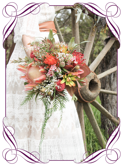 Australian native Silk Artificial Bridal Bouquet design, featuring faux flower king protea, burnt orange banksia, pepper berry, eucalyptus, rust leaves, Australian natives, and textures in a romantic elegant and unusual bridal style wedding flowers, rustic boho wedding bouquets. Made in Melbourne by Australia's Best Artificial Bridal Florist. Worldwide Shipping available