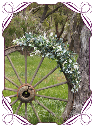 A Gorgeous Silk Artificial Australian native arbor arch wedding table decoration featuring faux flower mini lily orchids and Australian native gum leaves eucalypt, in a romantic elegant and unusual bridal style, rustic boho wedding decoration set. Made in Melbourne by Australia's Best Artificial Bridal Florist. Worldwide Shipping available