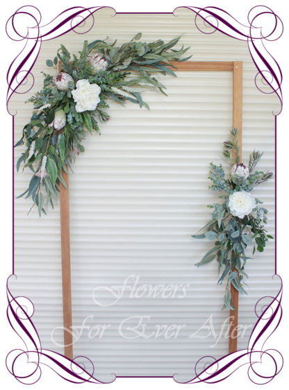 A Gorgeous Silk Artificial Australian native arbor arch wedding table decoration featuring faux flower roses, ivory protea, australian natives, and textures, gum leaves eucalypt, in a romantic elegant and unusual bridal style, rustic boho wedding decoration. Made in Melbourne by Australia's Best Artificial Bridal Florist. Worldwide Shipping available