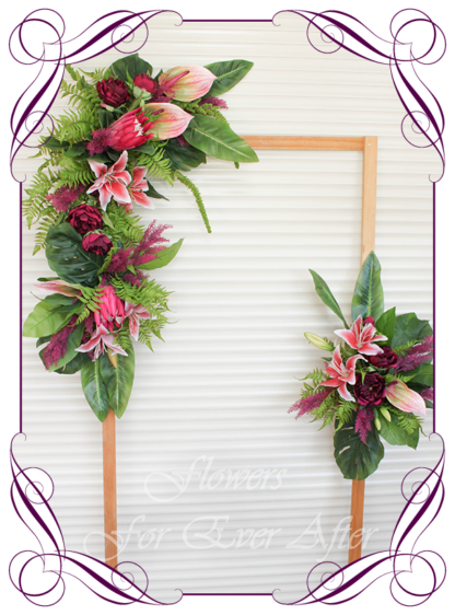 A Gorgeous Silk Artificial Australian tropical arbor arch wedding table decoration featuring faux flower lilies, anthurium, fuchsia pink protea, plum peonies, monsteria, wedding decoration set. Made in Melbourne by Australia's Best Artificial Bridal Florist. Worldwide Shipping available