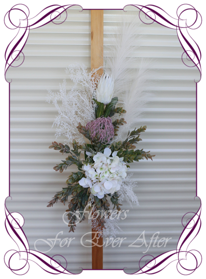 A Gorgeous Silk Artificial Australian native arbor arch wedding table decoration featuring faux flower hydrangea, ivory protea, australian natives, and textures, gum leaves eucalypt, in a romantic elegant and unusual bridal style, rustic boho wedding decoration. Made in Melbourne by Australia's Best Artificial Bridal Florist. Worldwide Shipping available