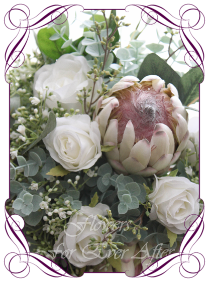 A Gorgeous Silk Artificial Protea Rose and Baby's Breath Bridal Bouquet posy, featuring faux flowers Australian native gum leaves in a romantic elegant and unusual bridal style, blush pink wedding flowers, native rustic wedding, boho flowers, traditional wedding bouquets. Made in Melbourne by Australia's Best Artificial Bridal Florist. Worldwide Shipping available