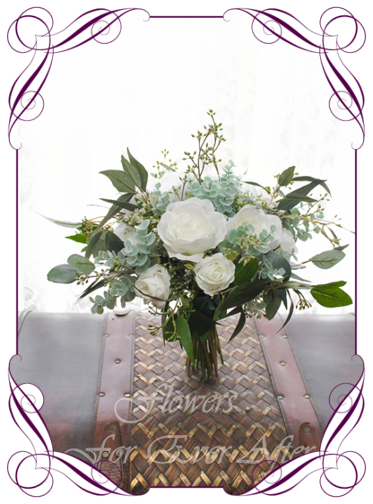 A Gorgeous Silk Artificial white Roses and Baby's Breath Bridal Bouquet posy, featuring faux flowers Australian native gum leaves in a romantic elegant and unusual bridal style, blush pink wedding flowers, native rustic wedding, boho flowers, traditional wedding bouquets. Made in Melbourne by Australia's Best Artificial Bridal Florist. Worldwide Shipping available