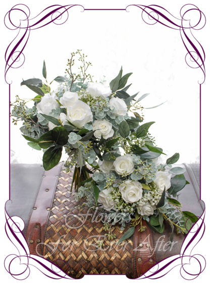 A Gorgeous Silk Artificial white Roses and Baby's Breath Bridal Bouquet posy package set, featuring faux flowers Australian native gum leaves in a romantic elegant and unusual bridal style, blush pink wedding flowers, native rustic wedding, boho flowers, traditional wedding bouquets. Made in Melbourne by Australia's Best Artificial Bridal Florist. Worldwide Shipping available