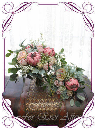 A Gorgeous Silk Artificial Pastel Pink Protea Rose and Baby's Breath Bridal Bouquet posy package set, featuring faux flowers Australian native gum leaves in a romantic elegant and unusual bridal style, blush pink wedding flowers, native rustic wedding, boho flowers, traditional wedding bouquets. Made in Melbourne by Australia's Best Artificial Bridal Florist. Worldwide Shipping available