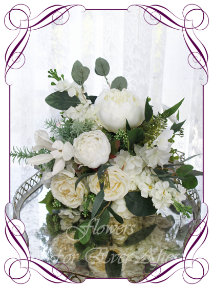 A Gorgeous Silk Artificial white peonies and roses Bridal Bouquet posy, featuring faux flowers with Australian native gum leaves boho romantic elegant and unusual bridal style, blush pink wedding flowers, native rustic wedding, boho flowers, traditional wedding bouquets. Made in Melbourne by Australia's Best Artificial Bridal Florist. Worldwide Shipping available