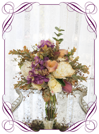 A Gorgeous Silk Artificial vintage cream, gold and purple mauve rustic Bridal Bouquet posy, featuring faux flowers with Australian native blue gum leaves rust boho romantic elegant and unusual bridal style, blush pink wedding flowers, native rustic wedding, boho flowers, traditional wedding bouquets. Made in Melbourne by Australia's Best Artificial Bridal Florist. Worldwide Shipping available