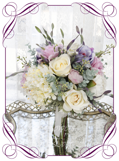 A Gorgeous Silk Artificial pink, lilac, and white rustic Bridal Bouquet posy, featuring faux flowers with Australian native blue gum leaves boho romantic elegant and unusual bridal style, blush pink wedding flowers, native rustic wedding, boho flowers, traditional wedding bouquets. Made in Melbourne by Australia's Best Artificial Bridal Florist. Worldwide Shipping available