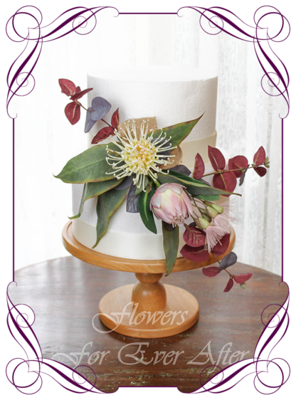 Realistic silk artificial fake flower rustic native Australian blush pink protea, burgundy blue gum, and pink gum flowers cake topper floral decoration. For fondant icing, naked cake, or cheese wheel cake.Made in Melbourne. Shipping world wide. Buy online