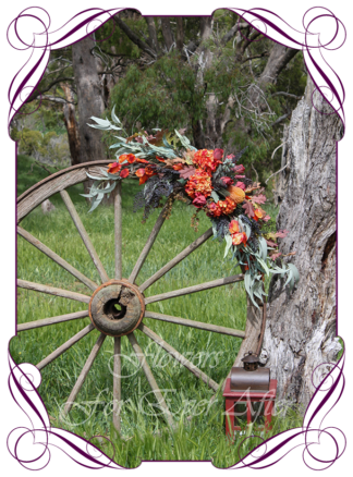 Silk artificial rustic Autumn Fall bridal wedding arbor arbour arch and table decoration. Burnt orange, burgundy, orange, coral, brown, black flowers and fall maple leaves. Made in Australia. Shipped world wide. Buy online wedding decorations
