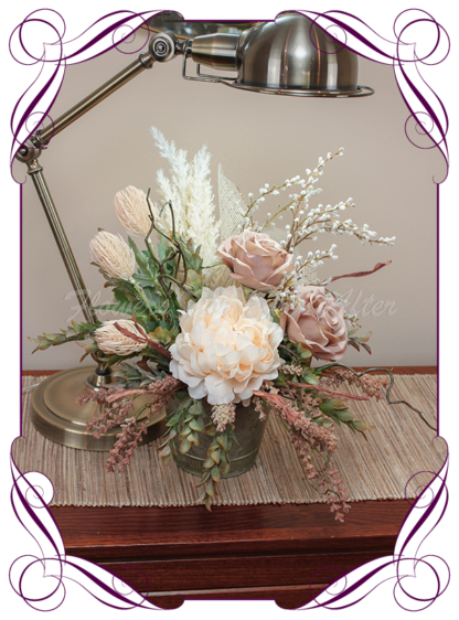 silk artificial gift arrangement in a rustic tin vase. Cream peony, pampas grass, dusty pink roses, white wattle, Australian native flowers and blue gum Australian native gum leaves. Buy on line , shipping world wide from Australians best florist online