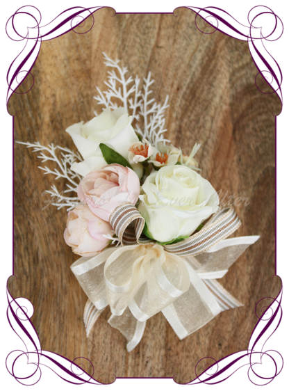 silk artificial ladies pinned or wrist corsage for wedding and formal / prom. Blush pink rose bud ivory white rose bud classic elegant corsage. Made in Melbourne Australia. Buy online, shipping world wide.