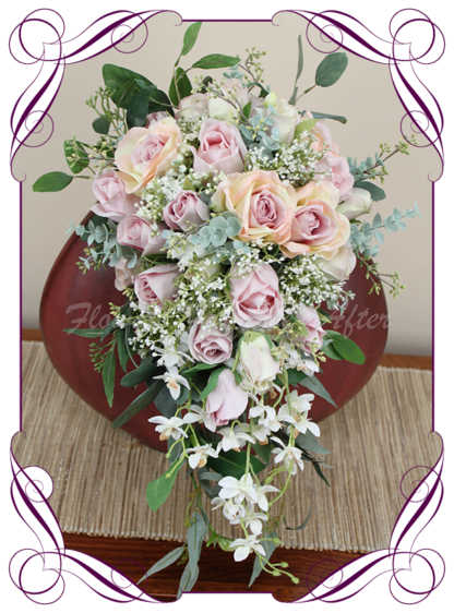 Silk artificial floral pastel pink tear cascade bridal wedding bouquet. Roses, baby's breath, Australian native gum leaves. Romantic elegant wedding flowers. Made in Melbourne Australia. Buy online, post worldwide.