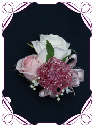 silk artificial ladies pinned or wrist corsage for wedding and formal / prom. Blush pink rose bud ivory white rose bud baby's breath with rose pink beaded bling accent flower. Made in Melbourne Australia. Buy online, shipping world wide.