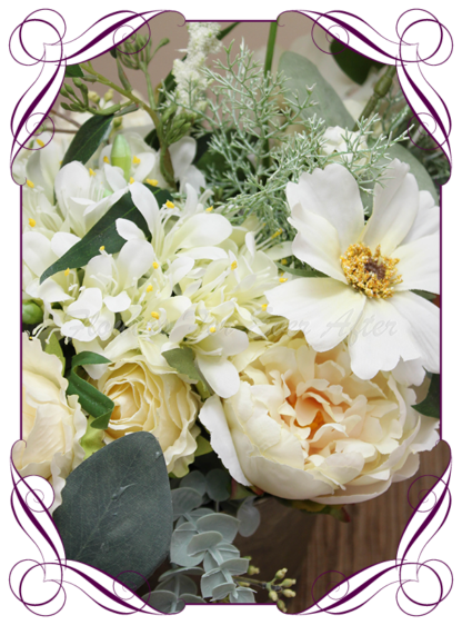 silk artificial gift arrangement in a vase. White cream and champagne peonies, roses and blue gum Australian native leaves. Buy on line , shipping world wide from Australians best florist online