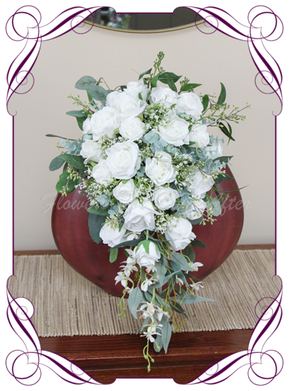 Silk artificial floral white tear cascade bridal wedding bouquet. Roses, baby's breath, Australian native gum leaves. Romantic elegant wedding flowers. Made in Melbourne Australia. Buy online, post worldwide.