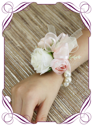 silk artificial childrens small ladies wrist corsage for wedding and formal / prom. Blush pink rose bud ivory white rose bud on pearl stretch bracelet. Made in Melbourne Australia. Buy online, shipping world wide.